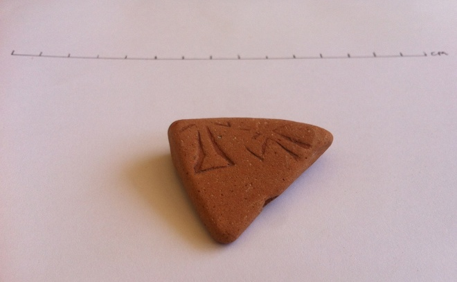 Pottery sherd with partial cross design